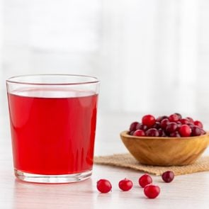 Glass with fresh organic cranberry juice.