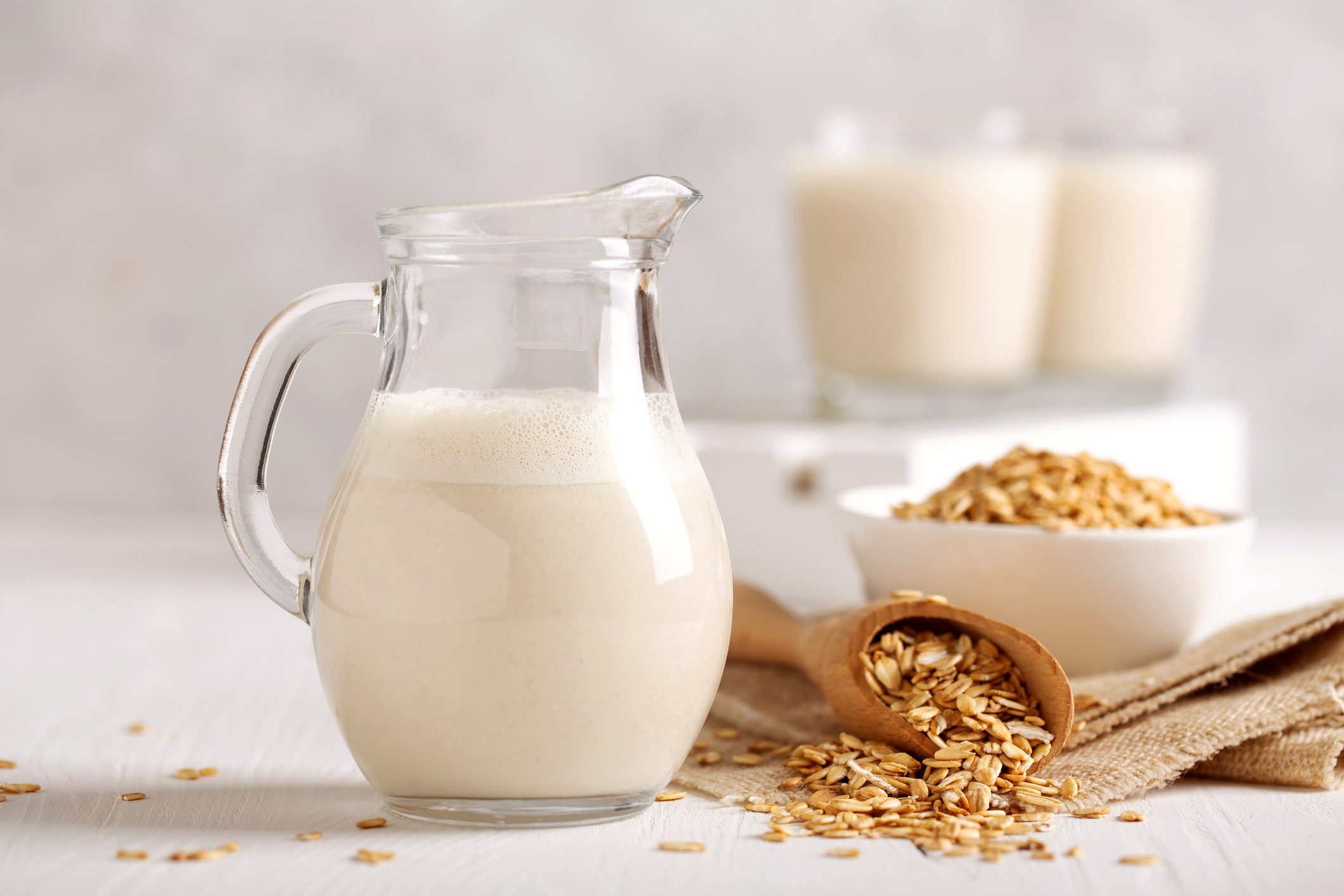 pitcher of oat milk and oats