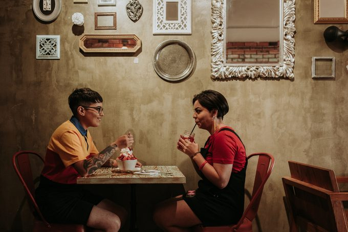 Two women on a date in cafe