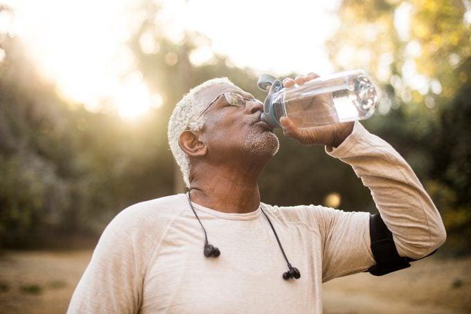 man drinking water from bottle