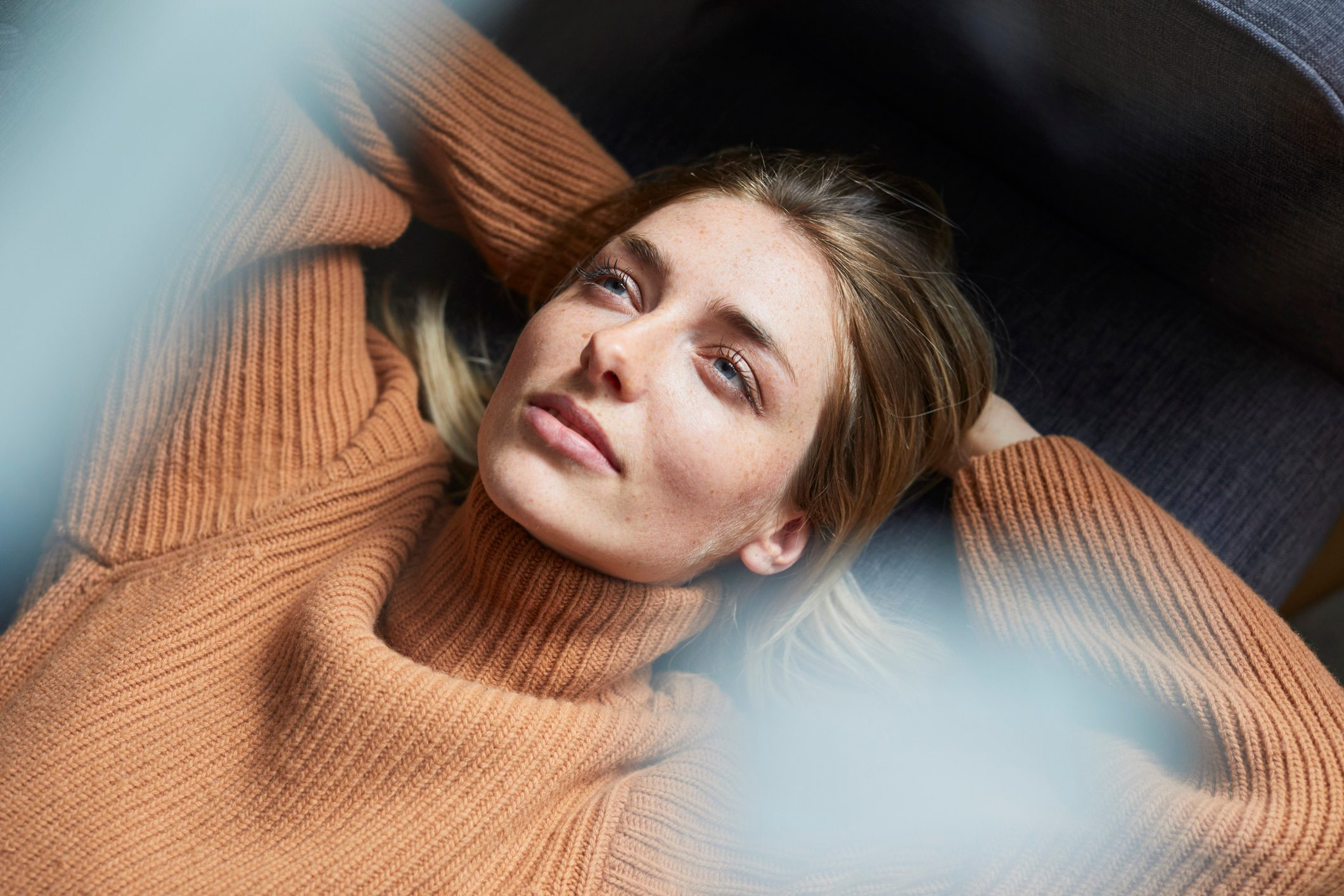 Portrait of woman relaxing and staring off