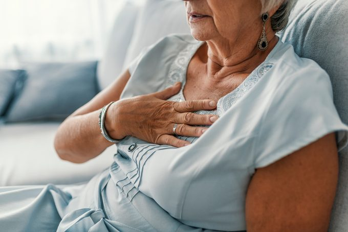 Woman having a pain in the heart area.