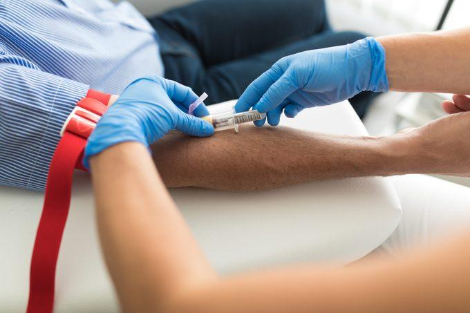Doctor taking blood