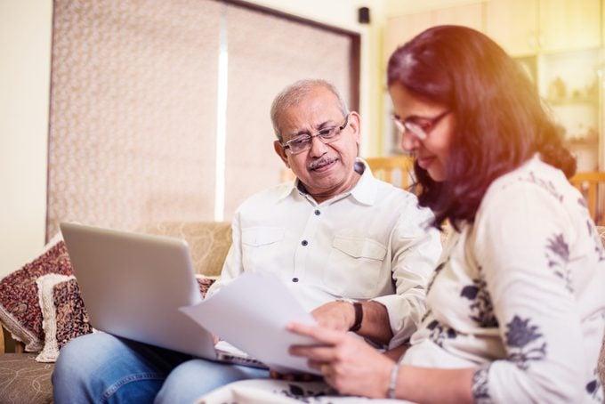 Senior couple reading paperwork together