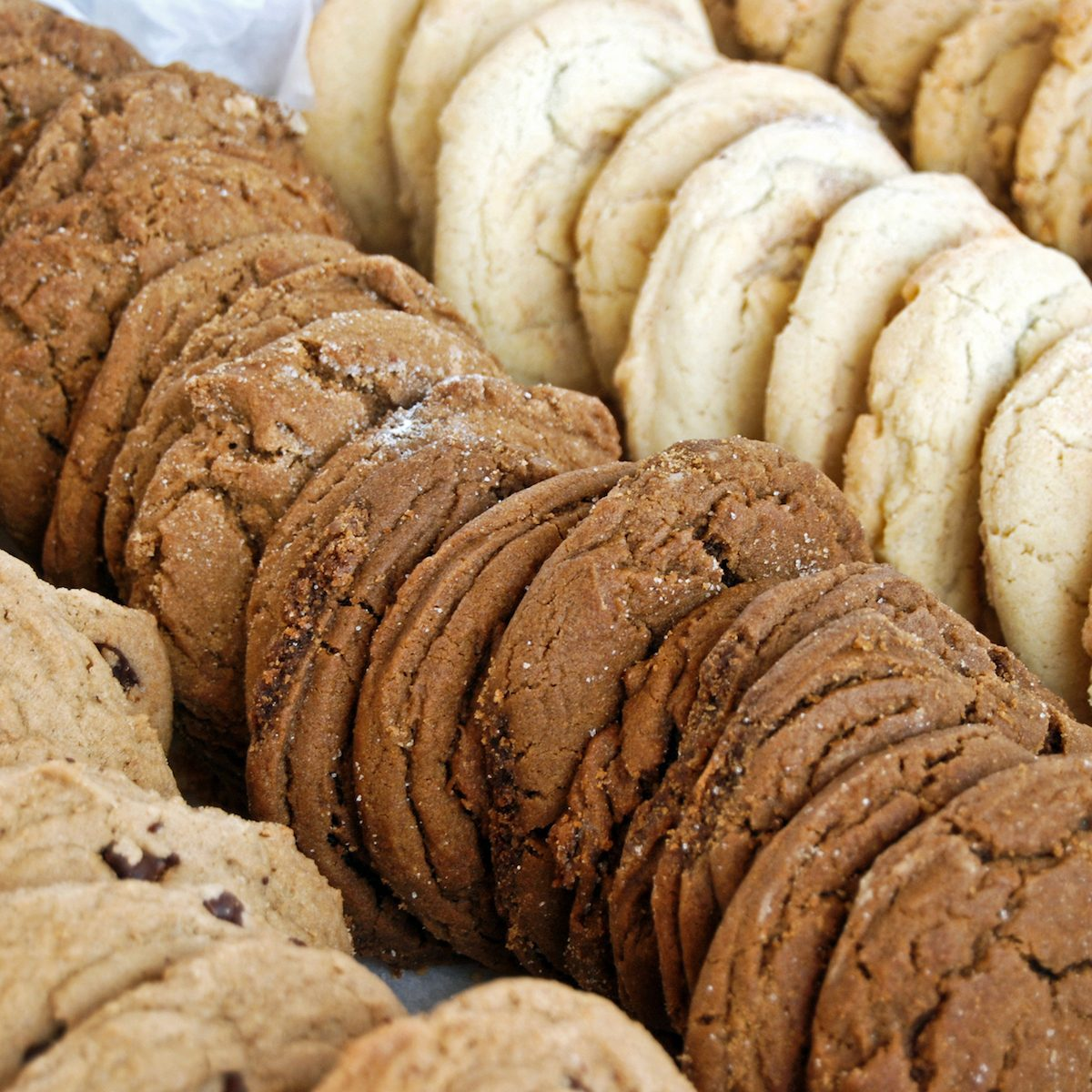 Various kinds of cookies arranged in a row.