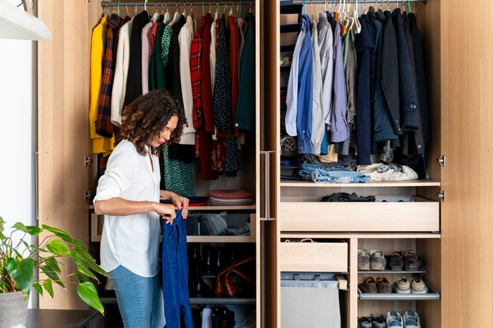 Woman Clearing Out Her Wardrobe 2