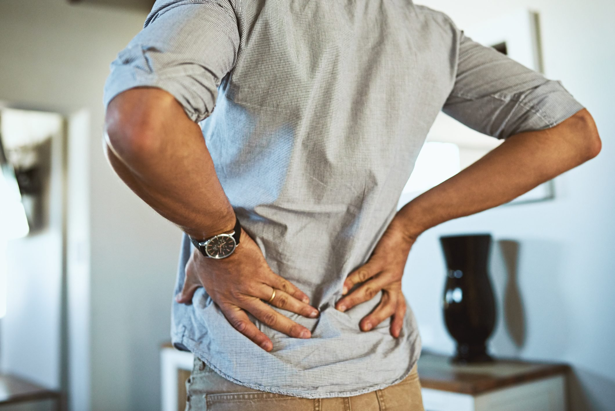 lower back pain and stretch close up