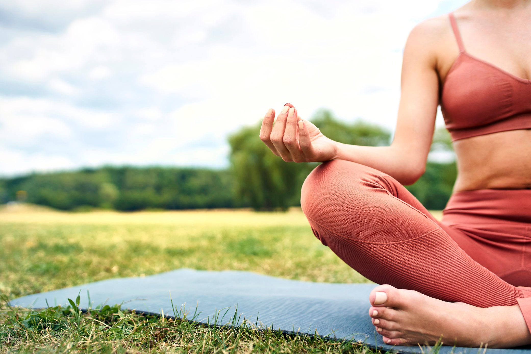 Close-up of woman practicing yoga in park