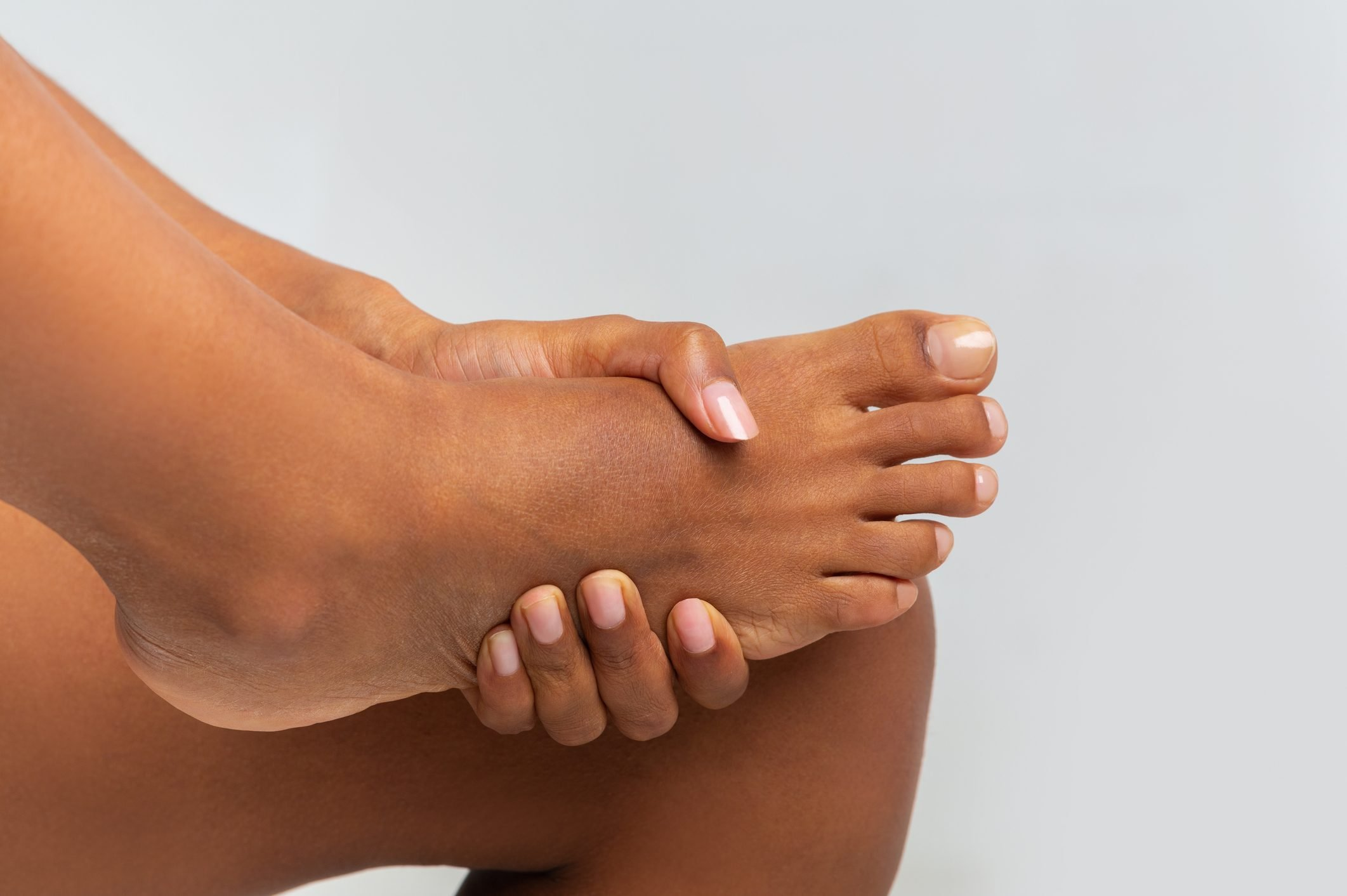 closeup of woman holding on to her foot