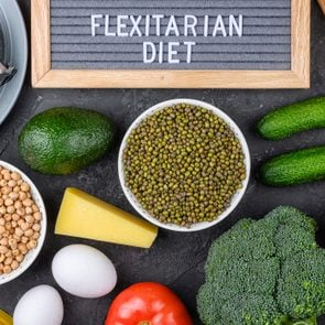 A set of products for a flexible diet. Felt plate with the inscription, a circle of vegetables, cereals and fish. Proper nutrition.