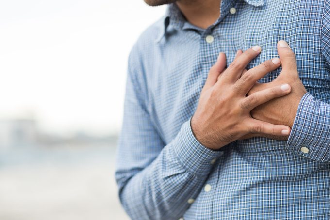 man with hands on his chest