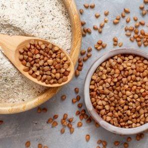 Buckwheat flour in a bowl and buckwheat grain
