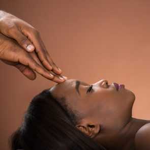 Woman Receiving Forehead Massage