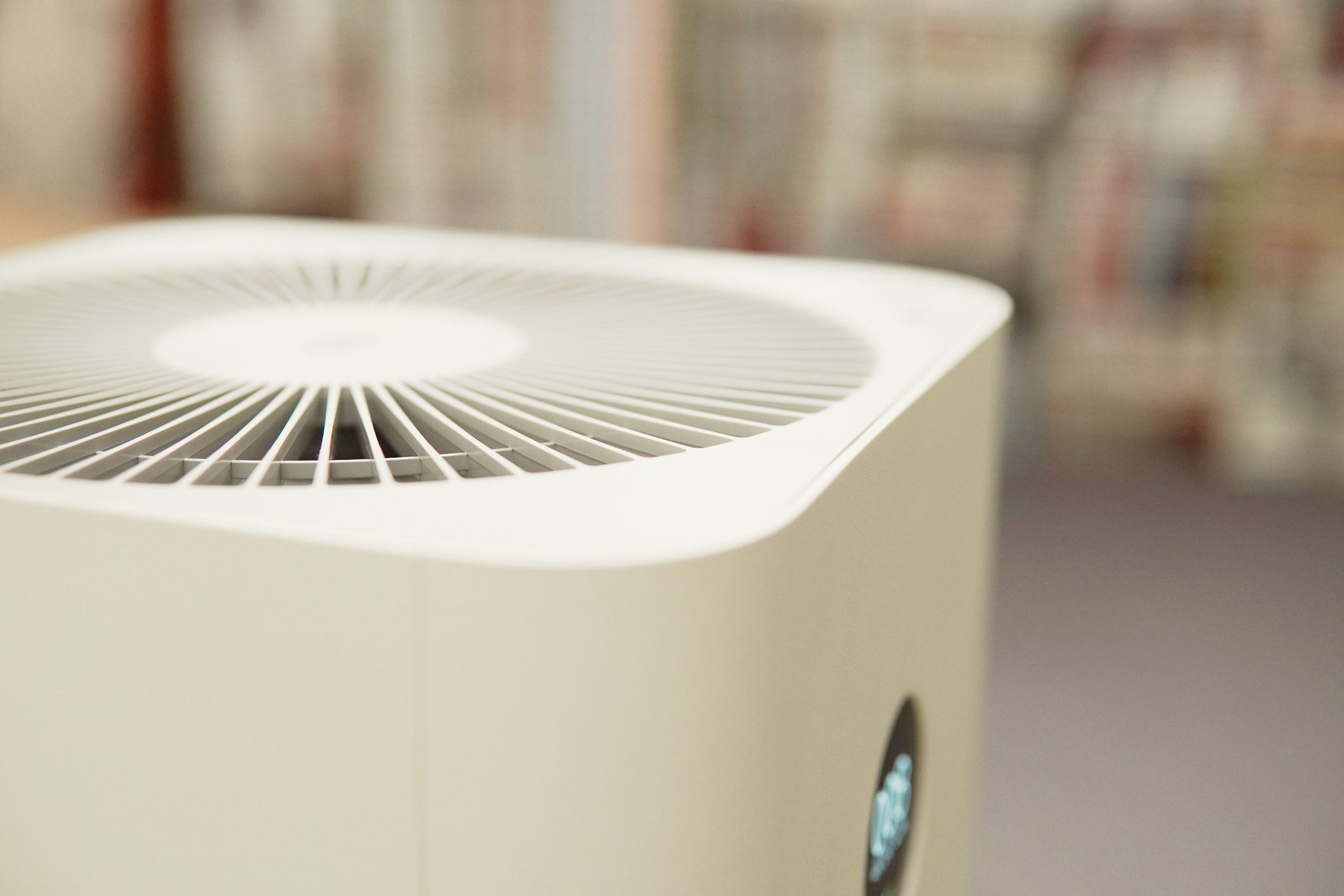 Closeup DOF of indoor air purifier in bedroom, air pollution PM 2.5, air quality, respiratory health concept