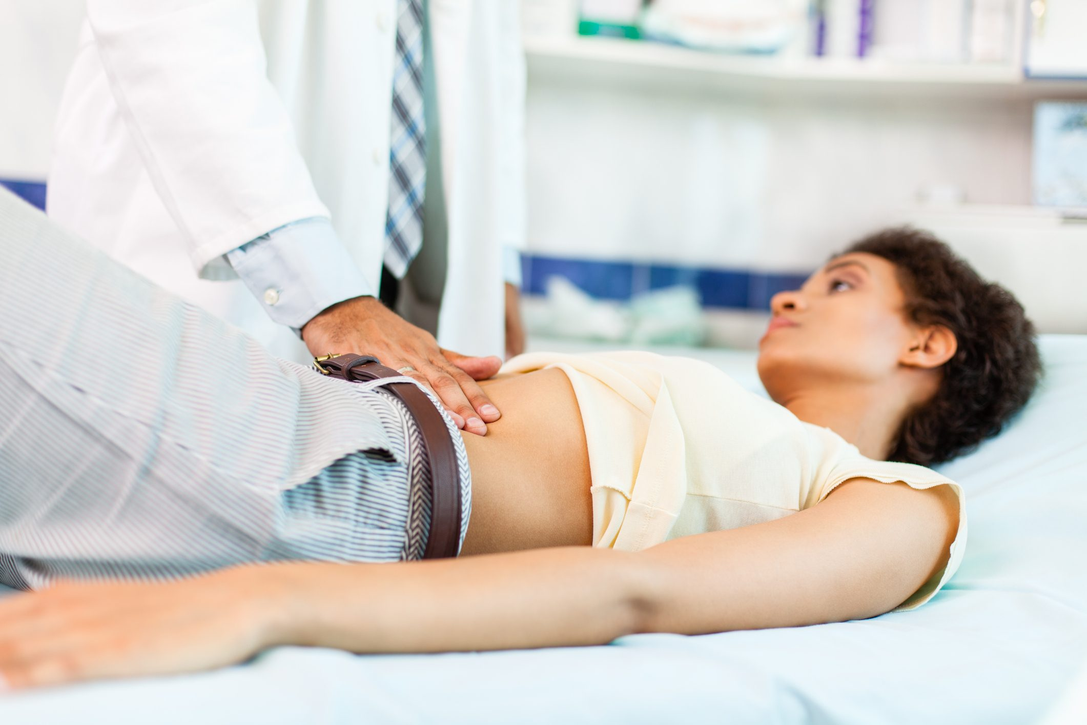 Woman with stomachache on medical exam