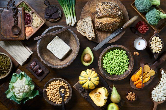 Vegan foods including vegetables and breads