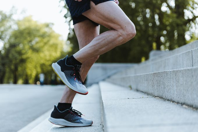 Close Up Of Legs Of man running up steps in sneakers