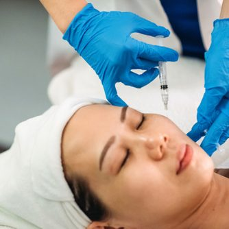 female receiving injection on the face at facial beauty salon