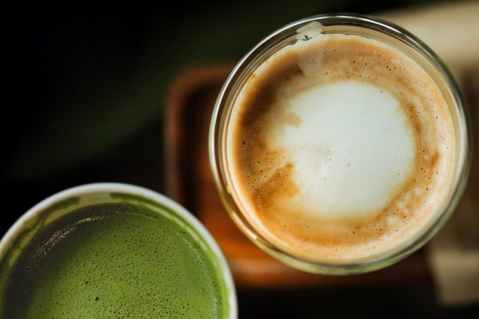 High Angle View Of Coffee And Juice On Table