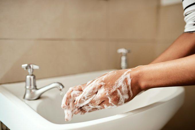 washing hands in bathroom sink close up