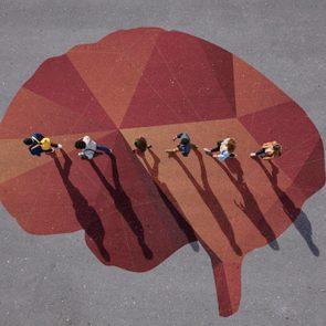 People walking in line across painted brain, on asphalt