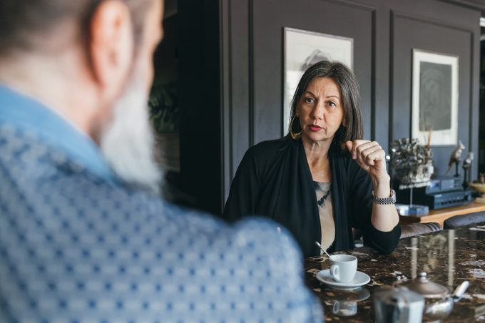 Couple in discussion over coffee in kitchen