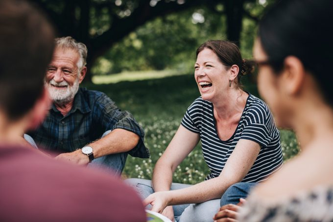 Cheerful woman in the park with her friends