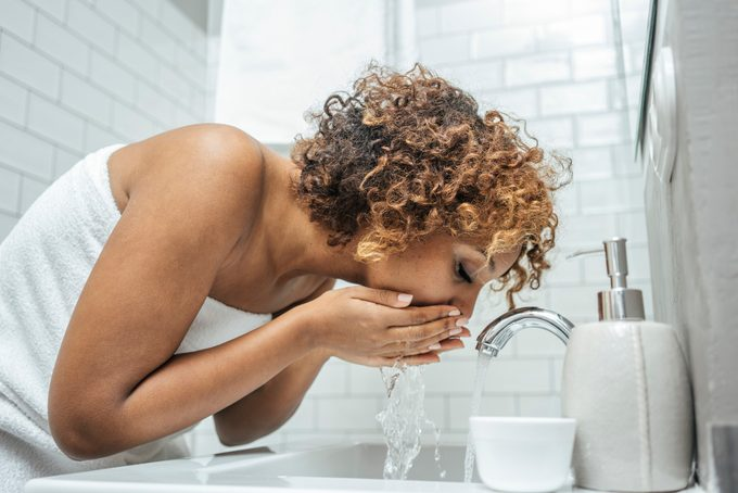Young woman at bathroom sink