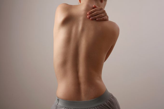 Woman with back pain, Scoliosis spine curve. Female body parts aesthetic, asymmetry