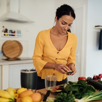 Attractive young vegan woman preparing food