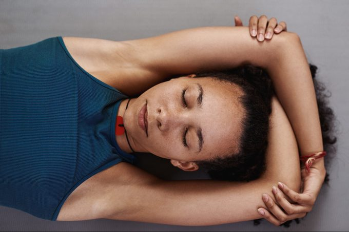woman lying down meditating shot from above