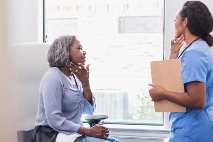Senior woman talks with dermatologist
