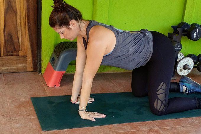 Kneeling Forearm Circles Stretch
