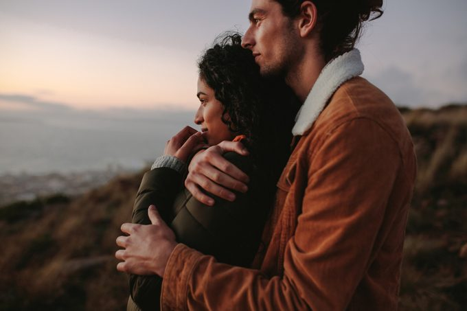 Romantic young couple standing in mountain