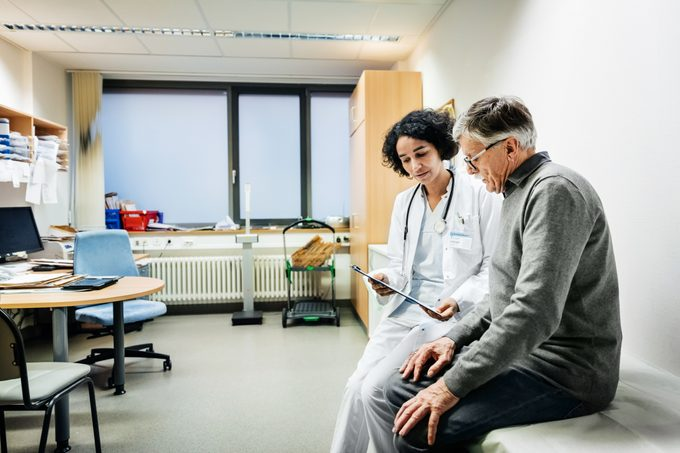 Elderly Man Talking To Doctor About Test Results
