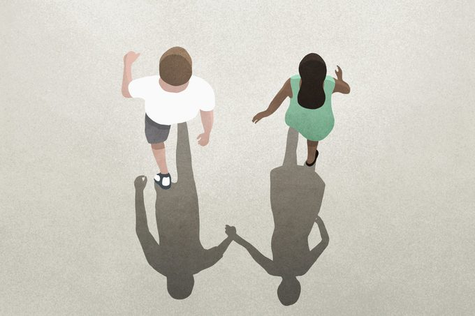 View from above shadow of couple holding hands