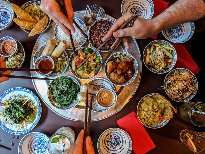 High Angle View Of People Eating Asian Food