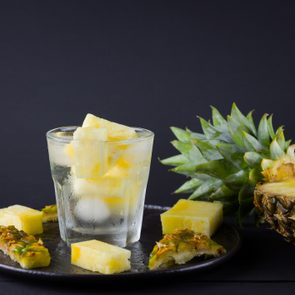 pineapple infused water on dark background