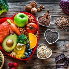 Healthy food for lower cholesterol and heart care shot on wooden table
