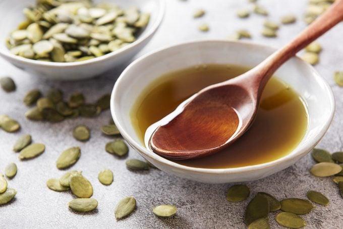 Bowl of pumpkin seed oil and pumpkin seeds