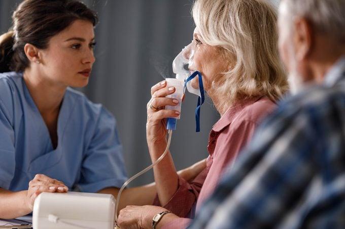 Inhaling through nebulizer at doctor's office