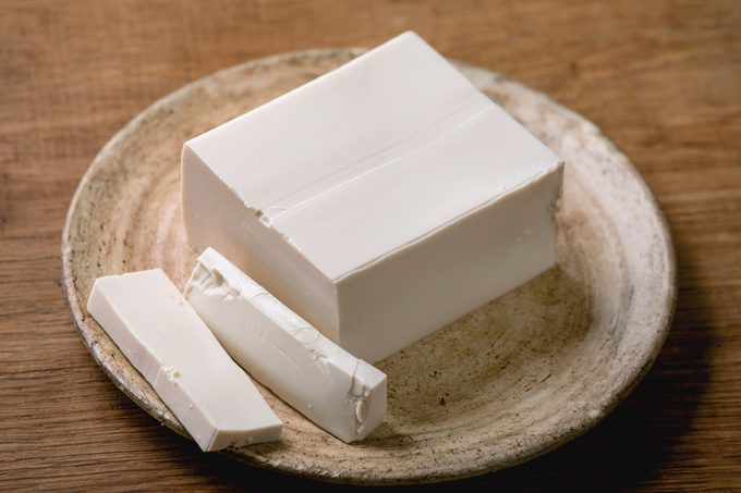 silken tofu on a plate on top of a wooden table