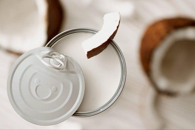open can of coconut cream or coconut milk
