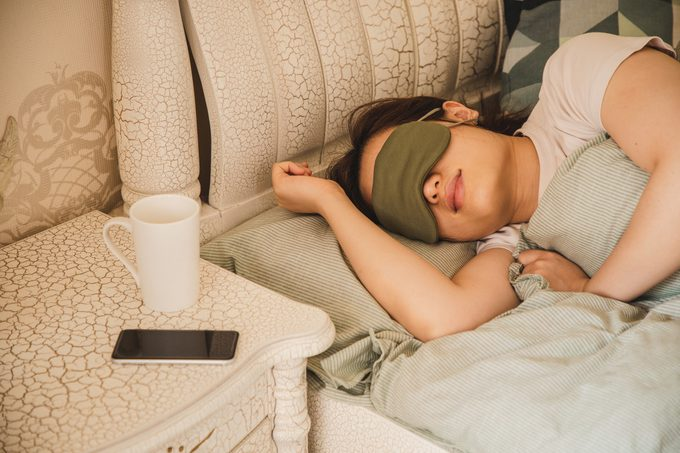 woman sleeping with eye mask on face