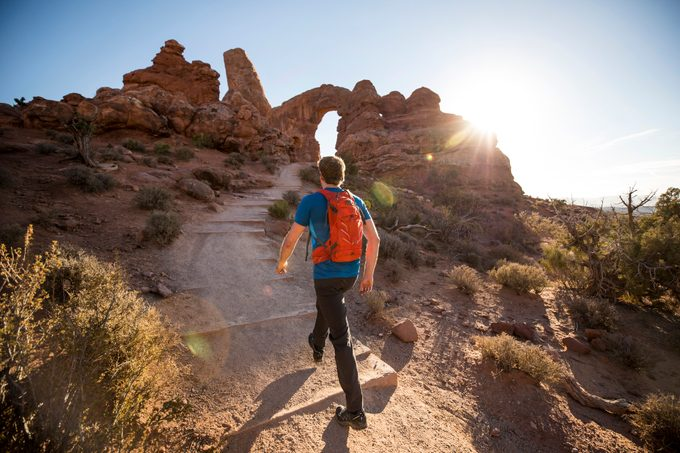 A man hiking in arches national park in Utah