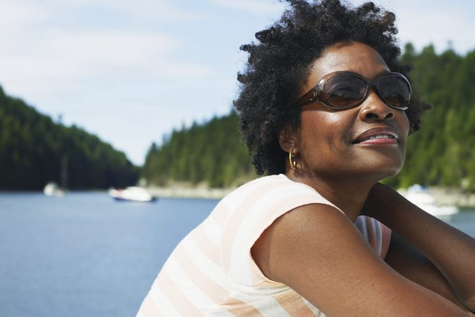 smiling woman wearing sunglasses in the summertime