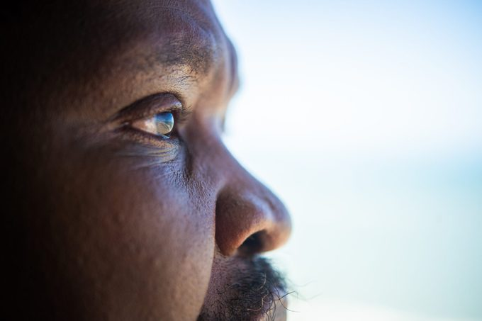 close up of senior man's eyes looking out to the ocean
