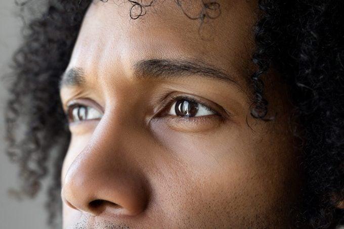 close up of man's eyes looking away